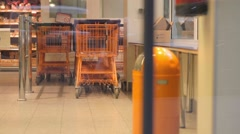 A baskets in supermarket through automatic doors Stock Footage