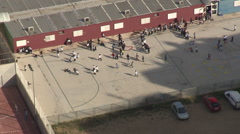 Children playing in school yard in Valencia (aerial view) - stock footage