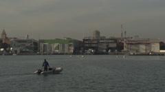 Dinghi crossing port of Valencia (Marina) Stock Footage