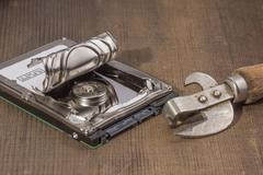 opening of the hard drive can opener - stock photo