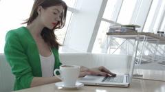 Attractive girl on cofee break in restaurant Stock Footage
