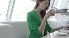 Attractive girl on cofee break in restaurant - stock footage