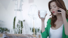 Attractive girl on coffee break in cafe - stock footage