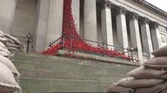 Stock Video Footage of ceramic poppies liverpool the weeping between sandbags