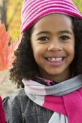 Child on autumn season portrait Stock Photos