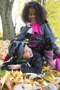 Childs on the leaf season. The autumn season - stock photo