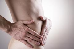 Pain in a mans body. Attack of appendicitis - stock photo