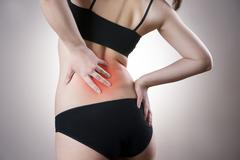 Pain in back of women - stock photo