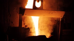 Smelting of the metal in the foundry at steel mill Stock Footage