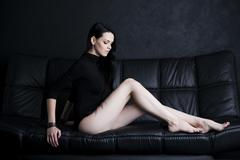 Beautiful young woman with long legs in bodysuit Stock Photos