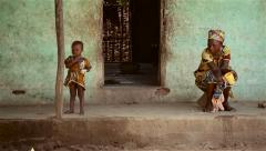 Africa native village grand mother and kids Stock Footage