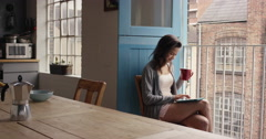 Morning coffee for mixed race woman happy at home in pajamas - stock footage