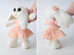 Toy bunny in a gift Stock Photos