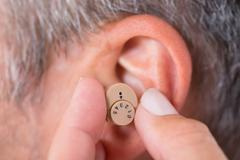 Stock Photo of Close-up Of A Man Wearing Hearing Aid In Ear