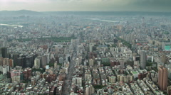 Time-lapse zoom panorama of giant city, Taipei, speeded up clouds and traffic Stock Footage