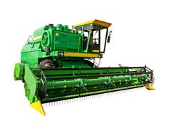 Green agricultural harvester Stock Photos