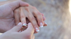 Bride and Groom exchanging wedding rings, closeup Stock Footage
