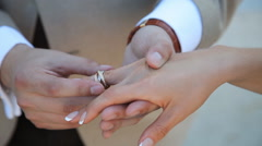 Bride and Groom exchanging wedding rings, closeup - stock footage