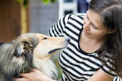 Girl with collie - stock photo