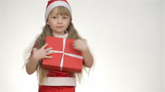 Kid holding a gift in a red box Stock Footage