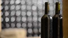 Bottle of red wine in an aging cellar.Close-up Stock Footage