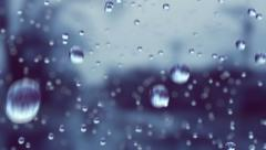 Beautiful Rain Drops in Slow Motion Falling. Stock Footage