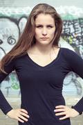 Young and beautiful girl posing against graffiti wall Stock Photos