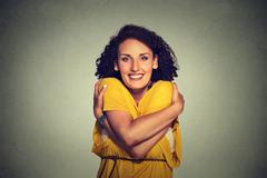 Happy smiling woman holding hugging herself Stock Photos