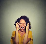 Very angry hysterical woman Stock Photos