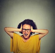 Stressed young woman screaming Stock Photos