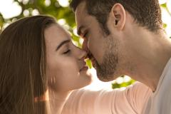 Young couple in love outdoor at the sunset Stock Photos