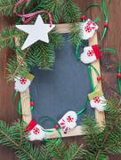 Christmas background with blank chalkboard - stock photo
