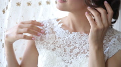 Bride wearing earrings - stock footage