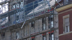 Scaffolding on side of building under construction 4k - stock footage