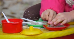Little Girl's Hands With PLastic Spoon Close View Girl Plays With Colorful Toy Stock Footage