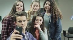 Teenage girls and boy making selfie on smart phone Stock Footage