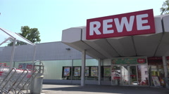 Rewe Grocery store entrance in Germany 4k - stock footage