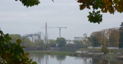 Object of Industry Cranes Buildings of Factory Plant at the River Lake Water Stock Footage