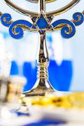 Table set with cocktails and chocolates to celebrate Hanukkah. - stock photo