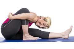 middle age woman doing yoga exercises - stock photo