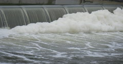 White Foam on The Watery Surfacein Small Waterfall Under the Dam Pollution of Stock Footage