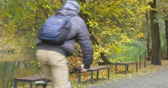 Man in Warm Hat Ushanka Hat With Fur Ear Flaps Warm Jacket Man with Backpack is Stock Footage