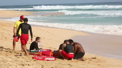 Male lifeguard rescuing an injured swimmer Stock Footage