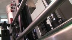 Wine bottles in a bottling line industry - stock footage