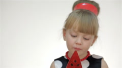 Kid girl with lollipop showing tongue - stock footage