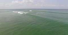 Over the surfers aerial 4k Stock Footage