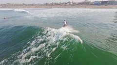 Surfer on a wave slow motion Stock Footage