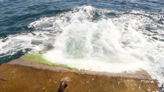 Running wave on a breakwater. Stock Footage