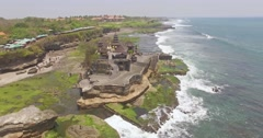 Over Tanah Lot temple Bali aerial 4k Stock Footage