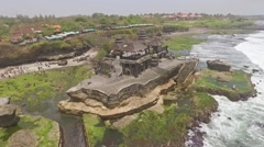Tanah Lot temple Bali aerial slow motion Stock Footage